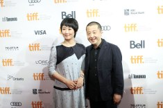 Zhao Tao and director Jia Zhangke attend the premiere of A Touch Of Sin at the TIFF building
