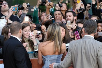 Fans jostle for a photograph of Jennifer Anniston during the final weekend of TIFF