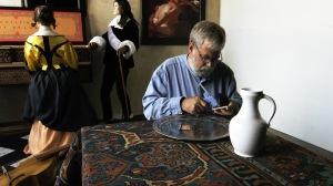 """Tim Jenison discovers a mistake in Vermeer's original painting of """"The Music Lesson."""" Photo by Shane F. Kelly, © 2013 High Delft Pictures LLC, Courtesy of Sony Pictures Classics. All Rights Reserved"""
