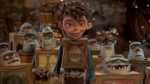 Boxtrolls Eggs  (Isaac Hempstead Wright) surrounded by Boxtroll friends. Courtesy of eOne Films 64811-1400.0900.fin.001._L.0184_CC