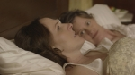 Emily (Molly Shannon) and Susan (Susan Ziegler) in bed – WILD NIGHTS WITH EMILY – Courtesy of GreenwichEntertainment